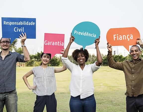 Foto de pessoas segurando balões com seguros: Responsabilidade Civil, Garantia, Previdência e Fiança - Interatividade Corretora de Seguros